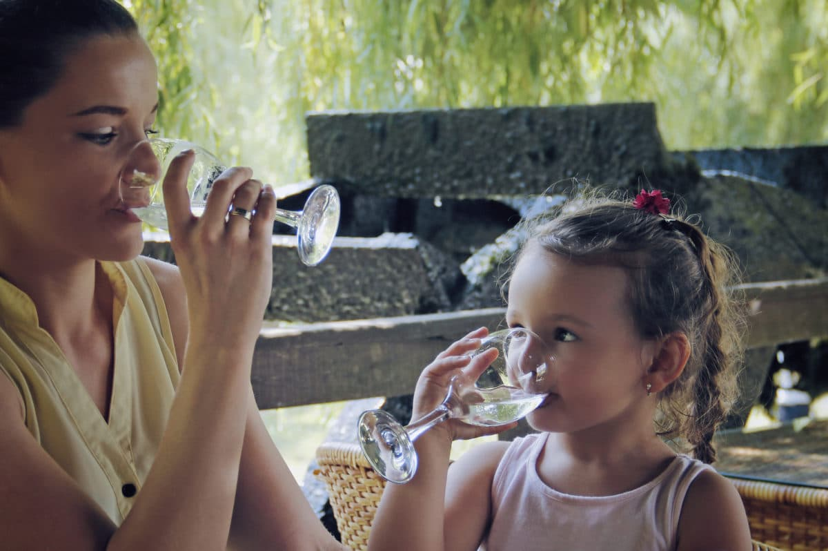 Mother and Daughter drink water, Mom and daughter drink water
